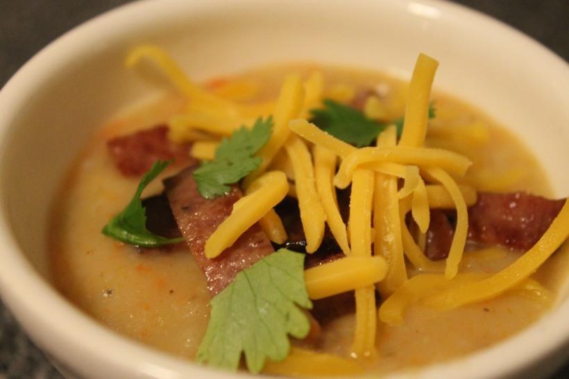 hearty potato soup garnished