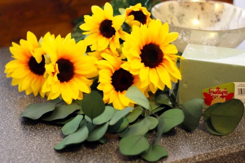 Simple diy sunflower eucalyptus centerpiece as gold